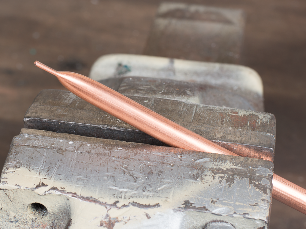 Squeezed ends copper microbore tube.